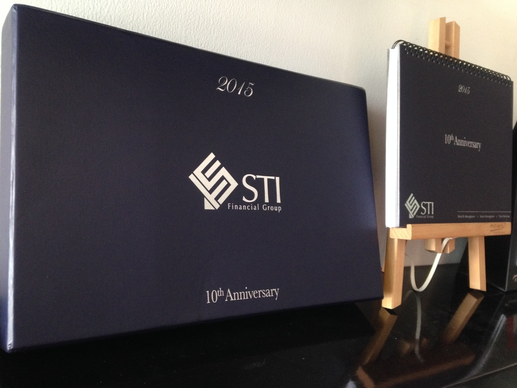 Creation of a New STI Finance Group Corporate Gift – Creation of a upscale STI Finance Group 10th Anniversary Year End Give away Calendar Gift set.